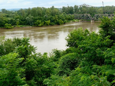 Missouri River Summer Landscape of the Mighty Big Muddy Mo and Riverbank Trees With Trestle Bridge in Atchison Kansas