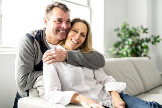 A Mature couple relaxing in couch at home