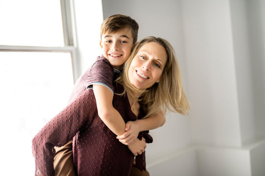 A people and family happy boy with mother at home