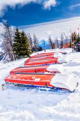 Ski Patrol Rescue Toboggans on Snow in Mountain Ski Resort