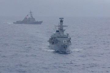 U.S. Navy handout photo of the Arleigh Burke-class guided-missile destroyer USS McCampbell and the Royal Navy Type 23 'Duke' Class guided-missile frigate HMS Argyll in the South China Sea
