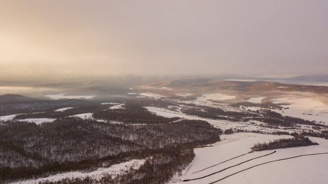 Sunset in the winter mountains landscape. Aerial view from above.