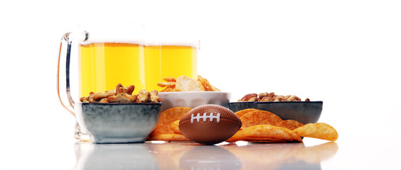 Chips, salty snacks, football and Beer on a table. Great for Bowl Game projects.