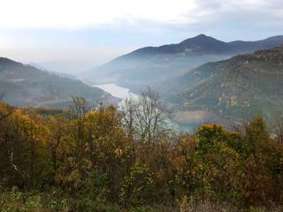 foggy lake and mountain landscape