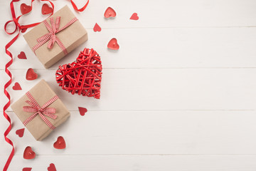 Valentine day composition: gift boxes and red hearts