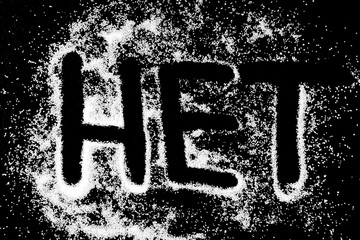 No word in russian language symbol drawing by finger on white snow salt powder on black background. Capital letters
