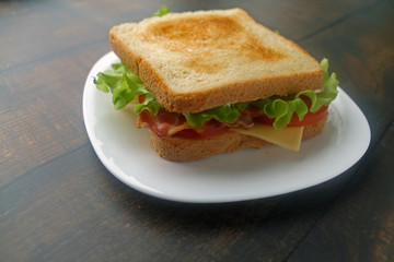 Fried eggs sandwich with bacon and cheese