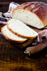 Homemade bread on a dark wooden background