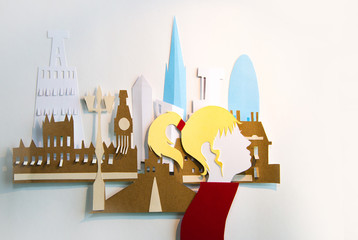 Young lady in the City. Paper cut design background