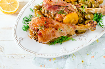 Baked turkey legs with Brussels sprouts and lemon