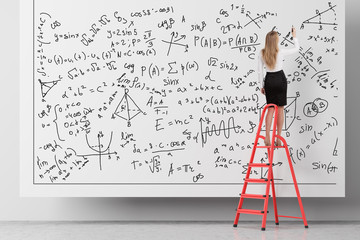 Woman on ladder writing formulas