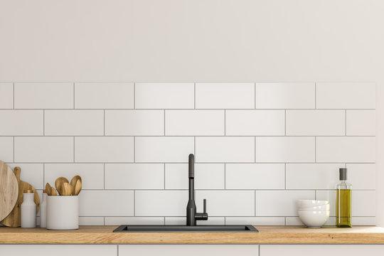 Sink in white kitchen