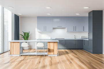 Light gray kitchen with wooden bar
