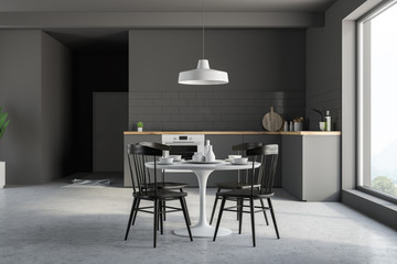 Small gray kitchen with table