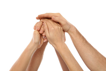 Young people holding hands together on white background, closeup. Team victory concept