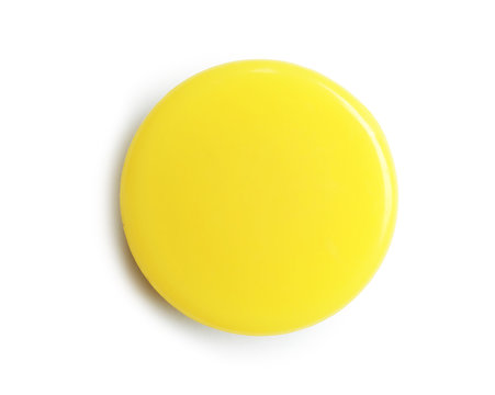 Bright yellow plastic magnet on white background, top view
