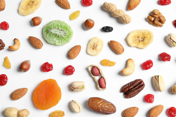 Flat lay composition of different dried fruits and nuts on white background