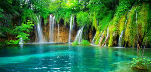Exotic waterfall and lake landscape of Plitvice Lakes National Park, UNESCO natural world heritage and famous travel destination of Croatia. The lakes are located in central Croatia (Croatia proper). Wall mural