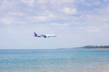 Airplane flying over sea at Phuket Thailand