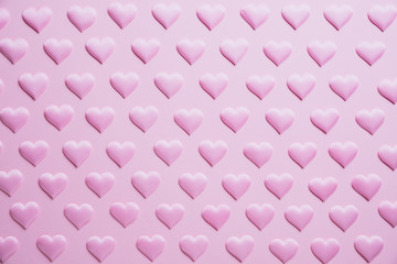 Valentines day and love concept. pink hearts background on pink.