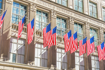 Many flags on the facade of The Saks Fifth Avenue department store in Midtown Manhattan in New York,USA