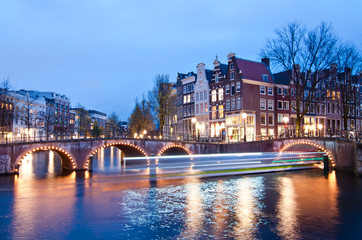 Keizersgracht intersection bridge view of Amsterdam canal and historical houses during twilight time, Netherland.
