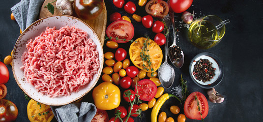 Ingredients for cooking - minced meat, tomatoes and spices.