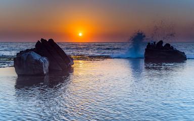 Splashy Sunrise Seascape and Rock Ledge