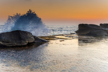 Splashy Sunrise Seascape and Rock Ledge