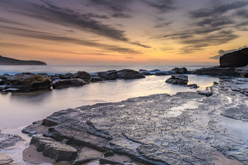 Dawn Sky over a Rocky Seascape