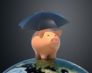 Piggy bank under umbrella.