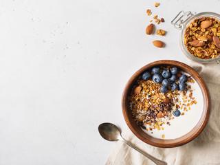 Homemade granola muesli with blueberries on white background breakfast