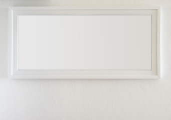 The white blank panoramic picture frame on white wall