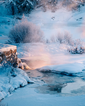 Icy winter sunset river