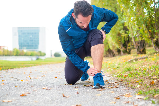 Sportsman suffering for ankle pain during training session