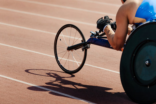 man athlete wheelchair racing competition in stadium