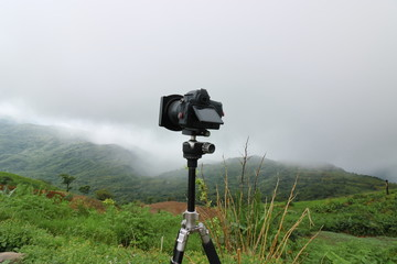 Photography view of digital camera with beautiful mountain background.