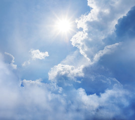 natural background, sparkle sun among a dense clouds