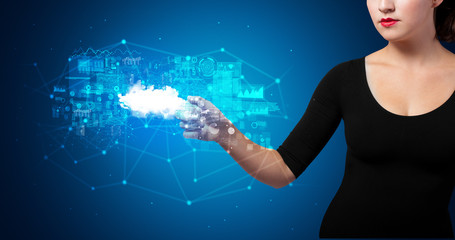 Woman touching hologram projection displaying information from cloud based system