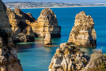 Beautiful panoramic sea view over rocks and cliffs in the Atlantic Ocean at Ponta da Piedade, Algarve region, Portugal