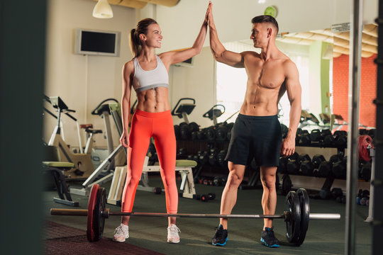 Young fit happy couple working out together
