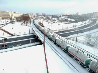 train on the bridge in Minsk, Belarus in winter, aerial photo from above