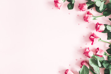 Flowers composition. Pink rose flowers on pastel pink background. Valentines day, mothers day,...