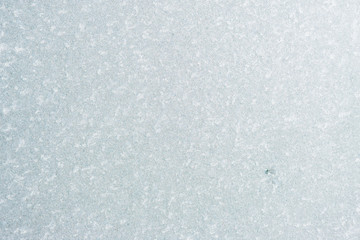 Winter background with gleaming ice. Frozen water texture. Copy space