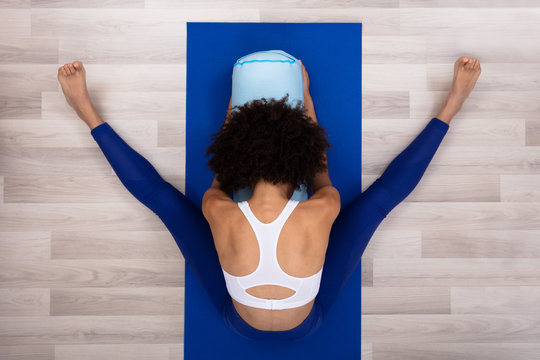 Slim Young Woman Exercising At Home