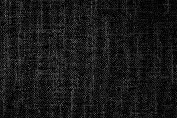 Black linen fabric texture or background.