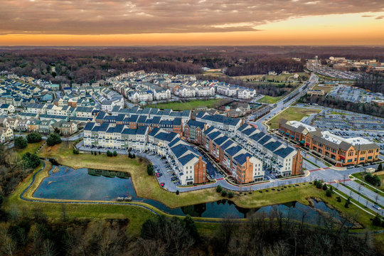 Aerial view of typical East Coast USA newly constructed suburban luxury townhouse community real estate in Maryland with brick facade the American Dream