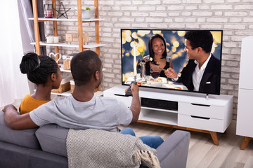 Happy African Couple Watching Television