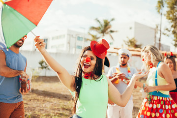 Brazilian Carnival. Young woman in costume enjoying the carnival party