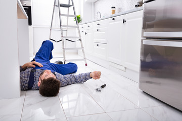 Unconscious Handyman Lying On Floor